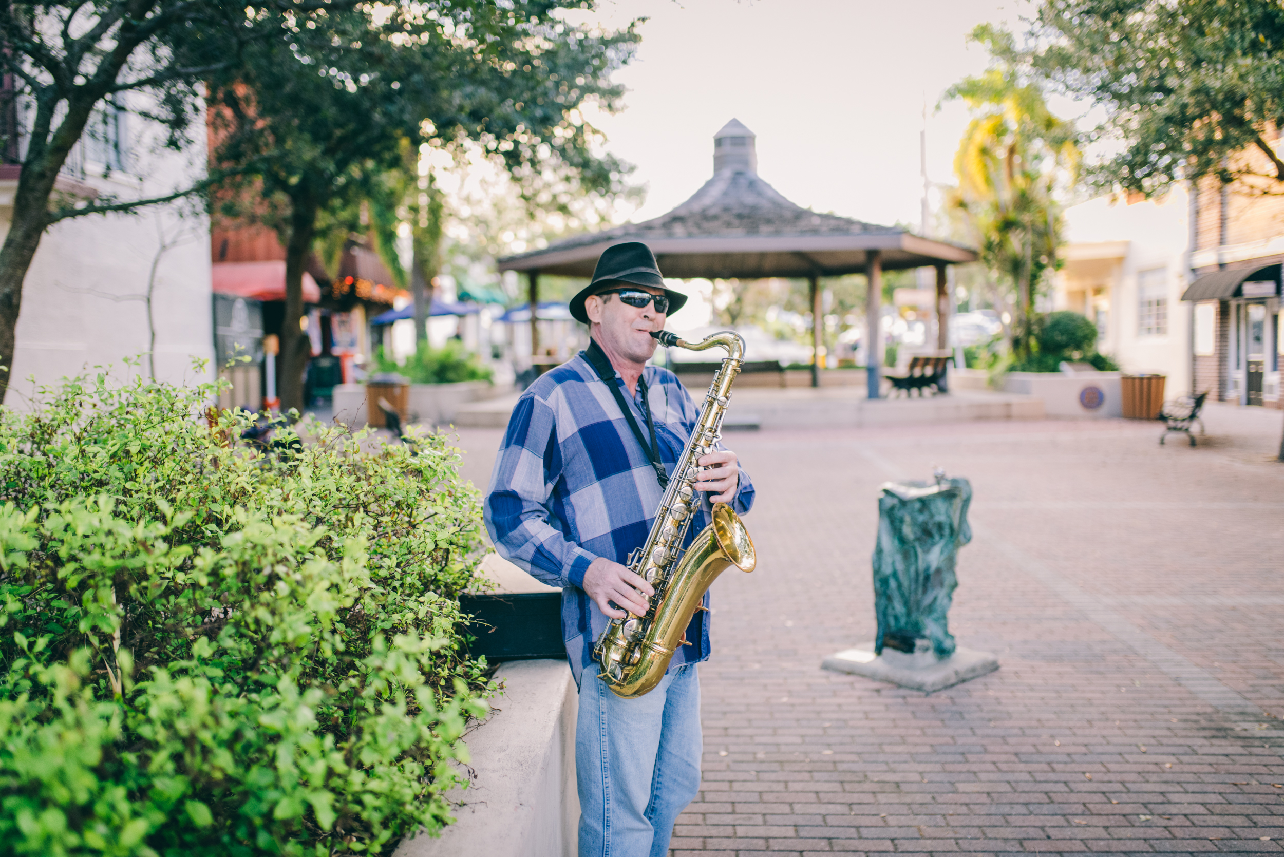 Man playing saxophone in Cocoa Viillage