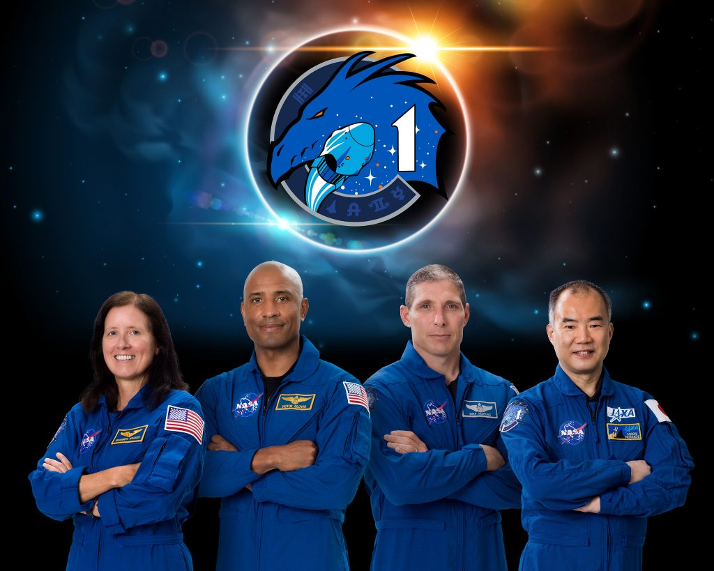 group photo of Mission specialist Shannon Walker, left, pilot Victor Glover, Crew Dragon commander Michael Hopkins and Japan Aerospace Exploration Agency (JAXA) astronaut and mission specialist Soichi Noguchi