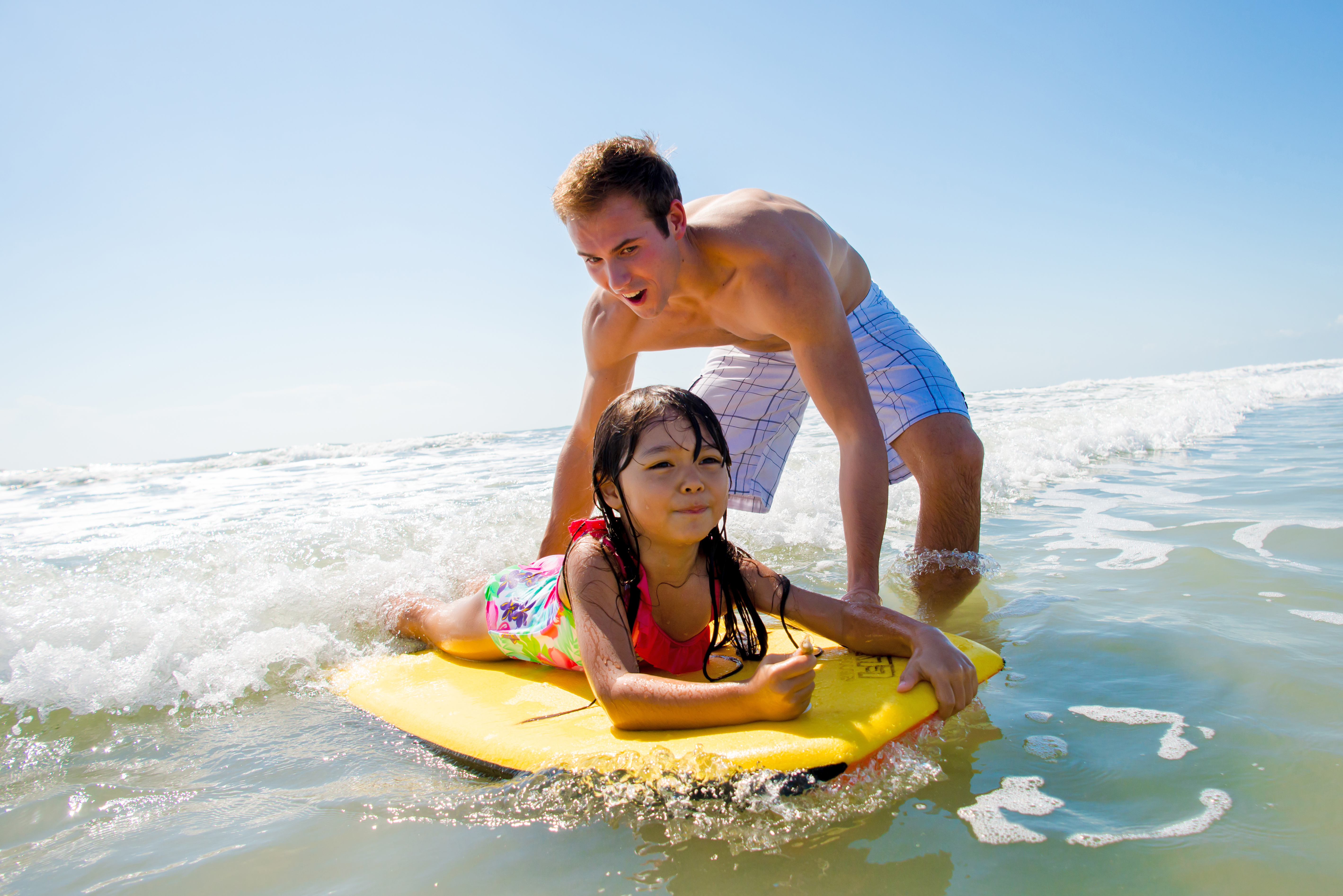 dad and daughter boogie boarding