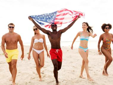Millennials celebrating 4th of July on the beach on Florida's Space Coast