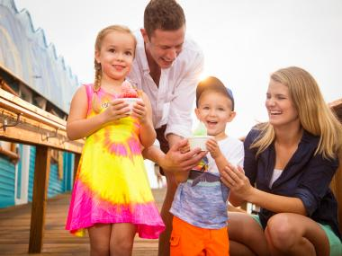 Family eating snow cones at the Westgate Cocoa Beach Pier