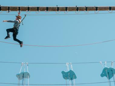 Overcoming the challenge of the ropes course at Cocoa Beach Aerial Adventures
