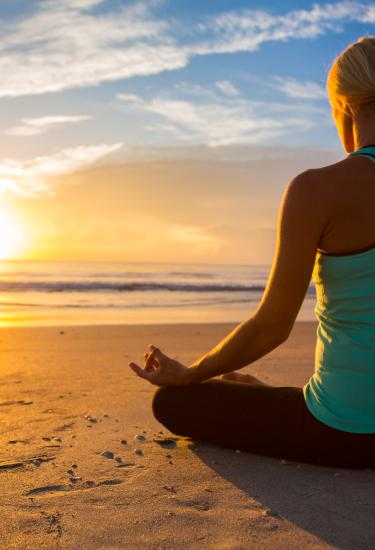 Yoga on the beach at sunrise