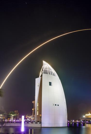 A night time rocket launch over the Exploration Tower in Port Canaveral
