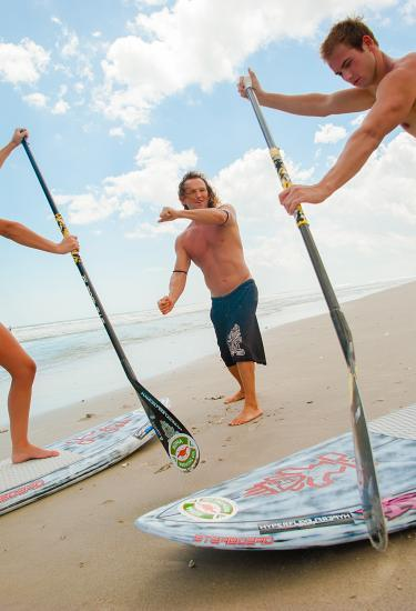 Getting stand-up paddle boarding lessons
