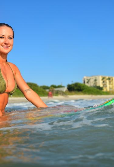 A surfer girl enjoys the waves at Melbourne and the Beaches