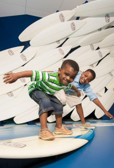 Kids enjoy an interactive surfboard art display at the Exploration in Port Canaveral