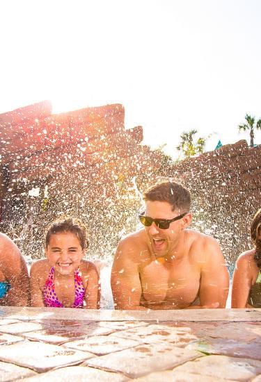 A family enjoys the pool at the Radisson Resort at the Port before a cruise vacation from Port Canaveral
