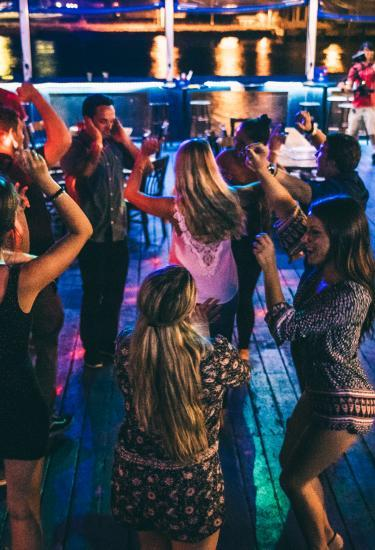 A group of millennials dancing and enjoying the nightlife at Fishlips Waterfront Bar & Grill in Port Canaveral