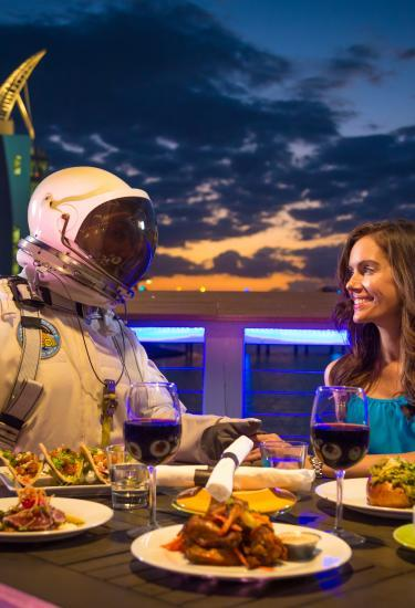 Starman and a woman enjoy outdoor dining at Rising Tide Tap & Table in Port Canaveral