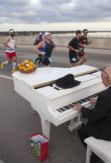 A piano player playing songs for runners in the Publix Florida Marathon in Melbourne, FL