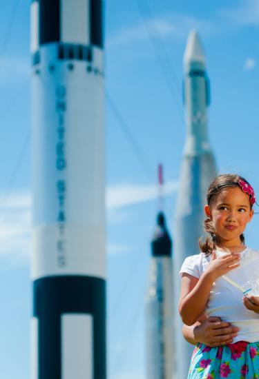 A mom and daughter check out the Rocket Garden at the Kennedy Space Center Visitor Complex