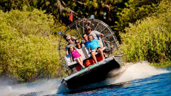 A family gets a nature and wildlife tour on an airboat tour