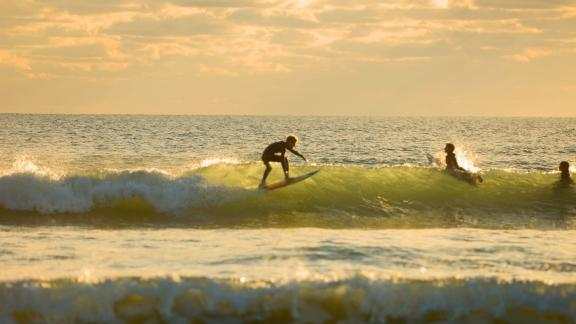Surfing a wave in Cocoa Beach