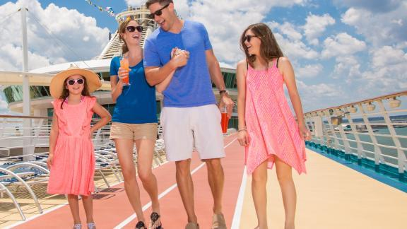 A family on the deck of a cruise ship during a cruise vacation from Port Canaveral