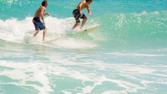 Men Surfing in Cocoa Beach in the Spring