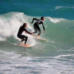 Surfing a wave at Jetty Park in Cape Canaveral