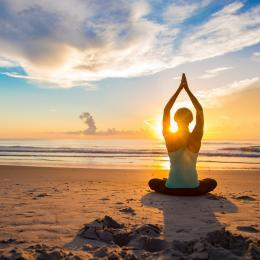 Relax and recharge with yoga on the beach at sunrise