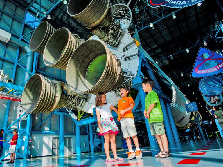 Kids having fun at the Saturn V Center at the Kennedy Space Center Visitor Complex in Titusville, FL