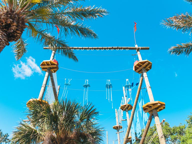 A view from the ground of the ropes course at Cocoa Beach Aerial Adventures