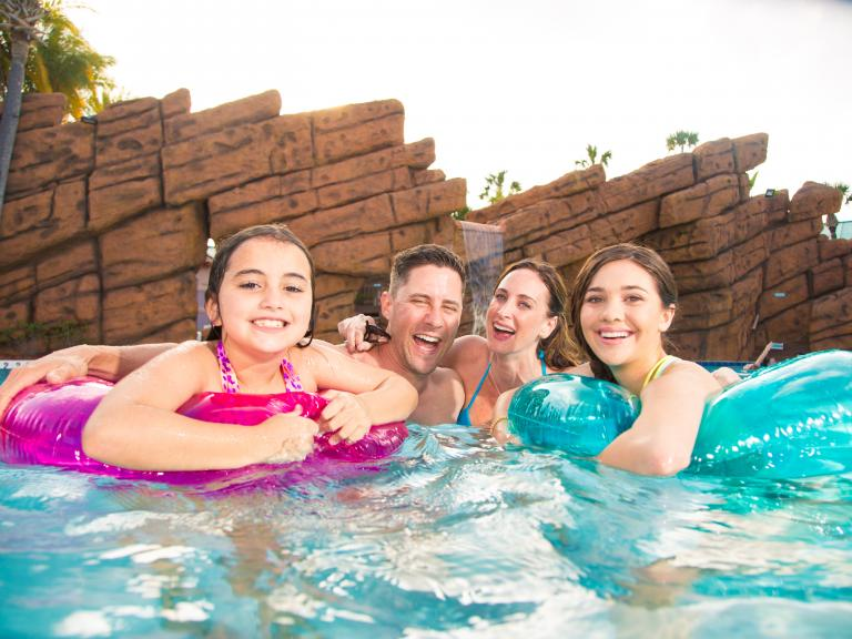A family enjoys the pool at the Radisson Resort at the Port in Cape Canaveral, FL