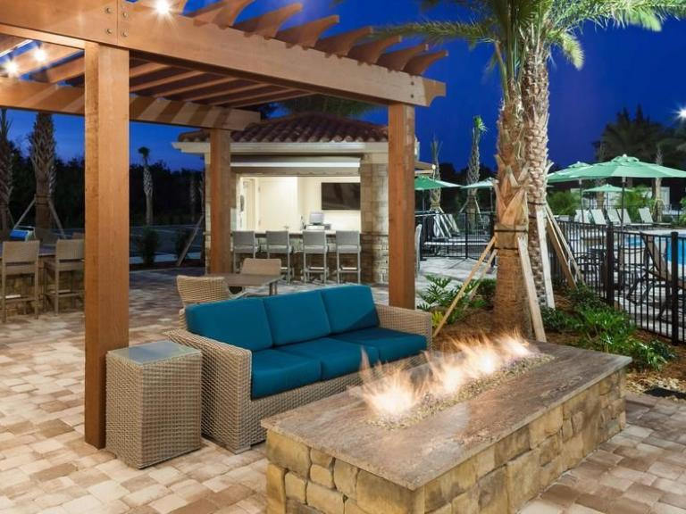 Outdoor seating and fire pit at the Homewood Suites by Hilton in Cape Canaveral, FL