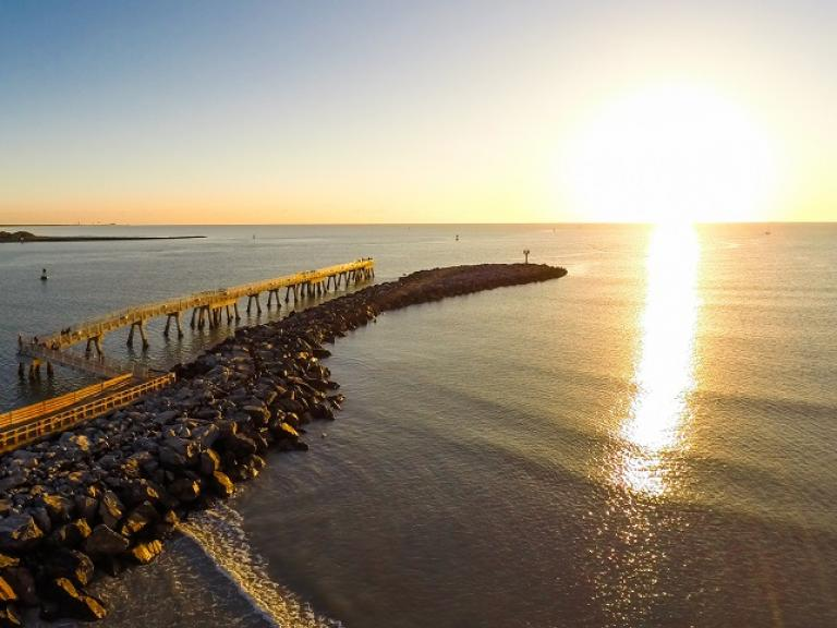 An aerial view of a sunrise over the jetty at Jetty Park in Port Canaveral