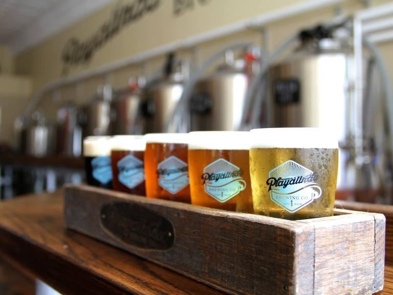 A flight of craft beer at Playalinda Brewing Company Hardware Store location in Downtown Titusville