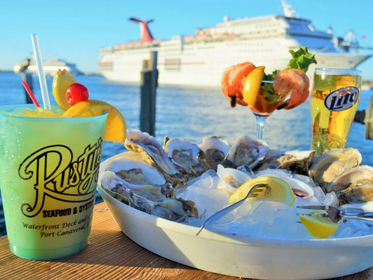 Fresh oysters and waterfront views at Rusty's Seafood & Oyster Bar in Port Canaveral, FL