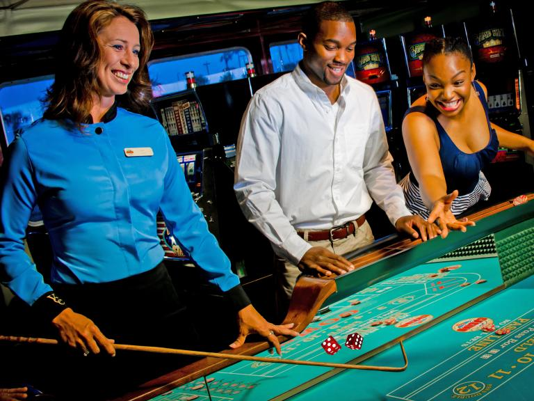 People playing craps on board the Victory Casino Cruise out of Port Canaveral