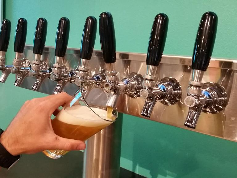 Pouring a beer from the tap at the Dirty Oar Beer Co. in Cocoa Village