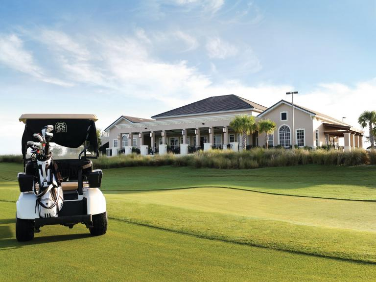 A golf cart in front of the club house at thew Duran Golf Club in Viera, FL