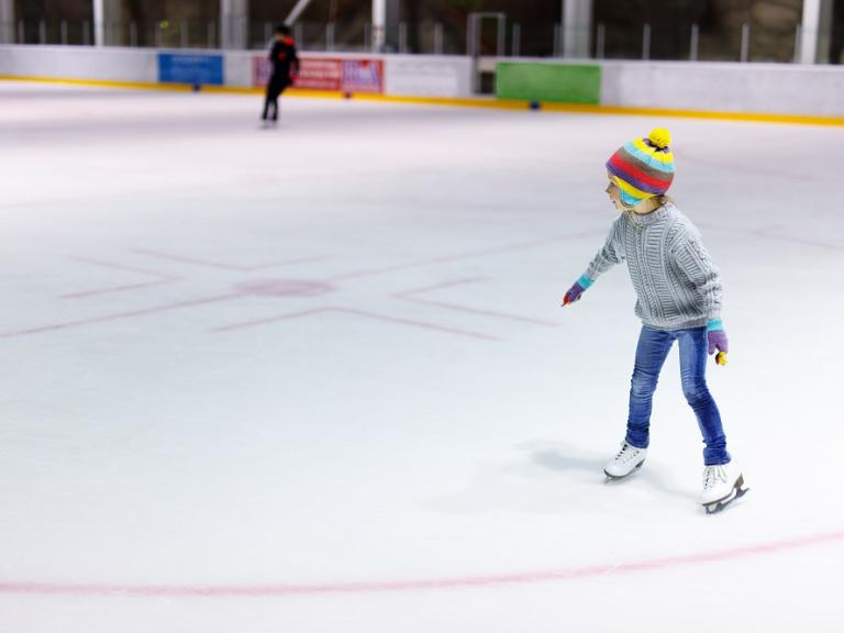 A little girl ice skating at the Space Coast Iceplex in Rockledge, FL