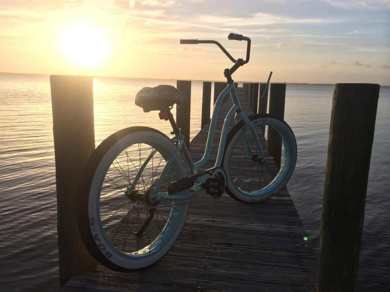 A bicycle on a dock overlooking the Indian River on Florida's Space Coast