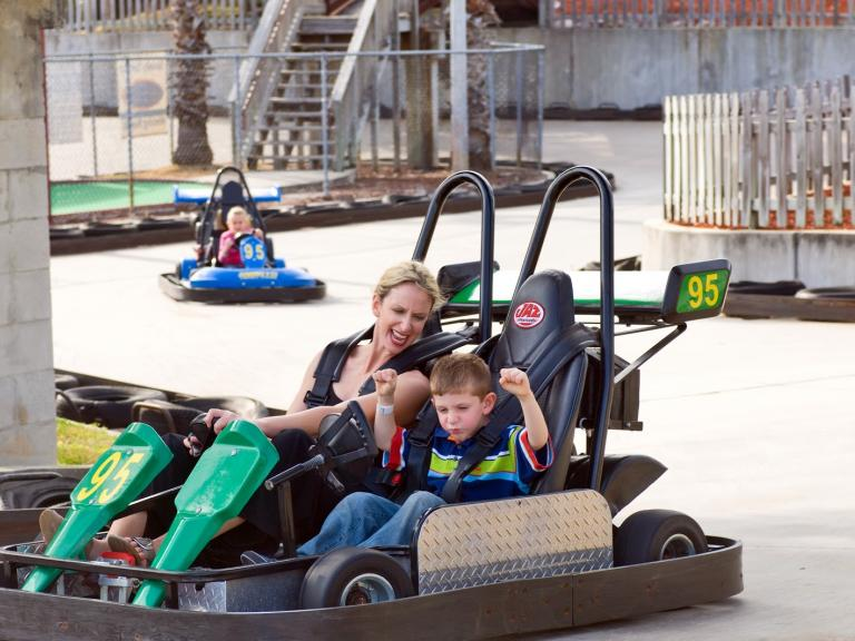 A mom and son enjoy the go-carts at the Andretti Thrill Park in Melbourne, FL