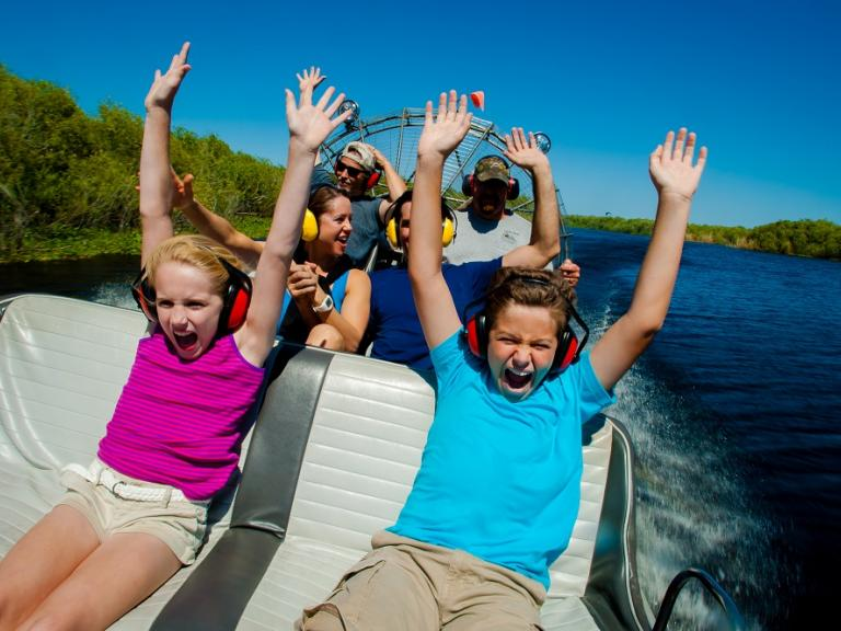 A family and kids having fun on an airboat tour in Melbourne, FL