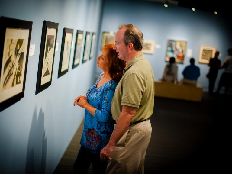 A couple admires the art work at the Foosaner Art Museum
