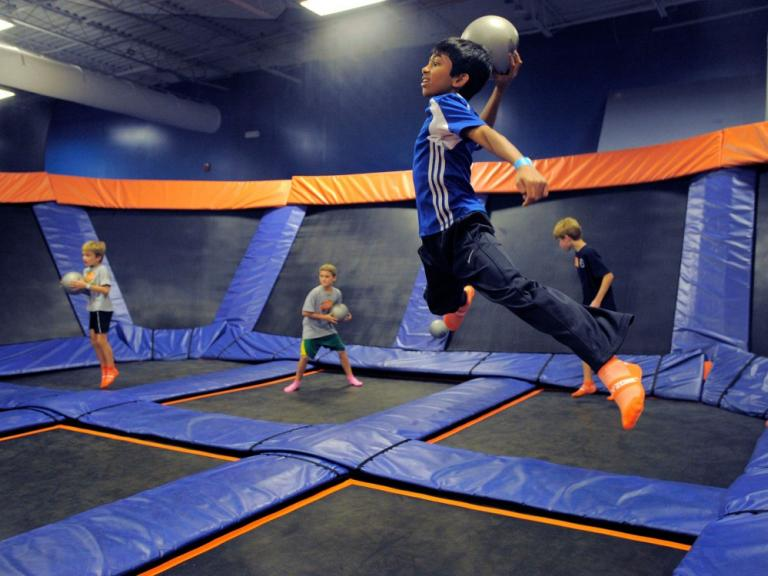 Kids jumping on trampolines and playing dodgeball at the Sky Zone Indoor Trampoline Park in Rockledge, FL