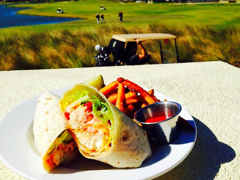 A fresh wrap from Tradewinds Restaurant at Duran Golf Club overlooking the golf course