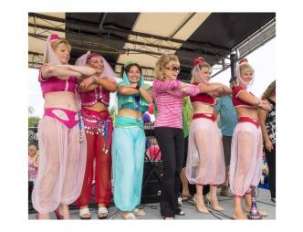 Barbara Eden and Jeannie lookalikes on stage