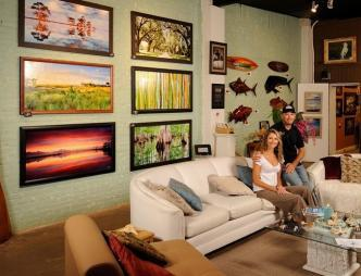 Heidi and Jeff posing in their showroom