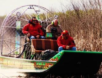 Airboat Rides of Melbourne Men Enjoying an Airboat Ride