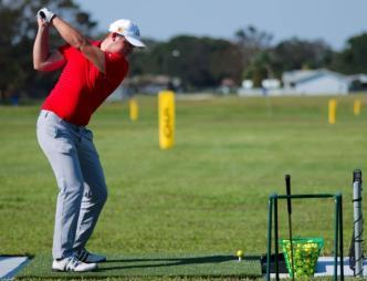 Practicing at the Singleton Golf Driving Range in Titusville, FL