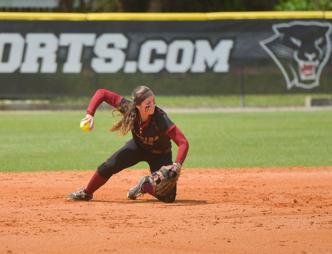A softball player throwing the ball in a game at the Florida Institute of Technology