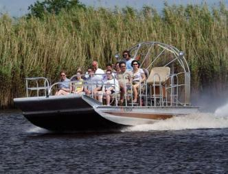 Grasshopper Airboat Eco-Tours Group on Airboat in Water