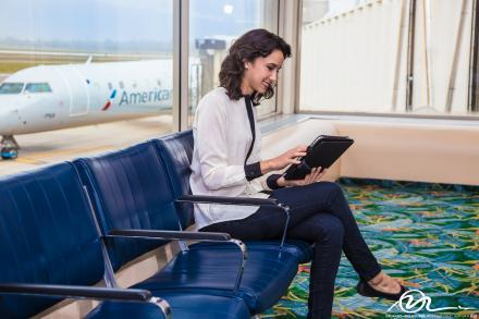 A woman using the complimentary WiFi at the Orlando Melbourne International Airport