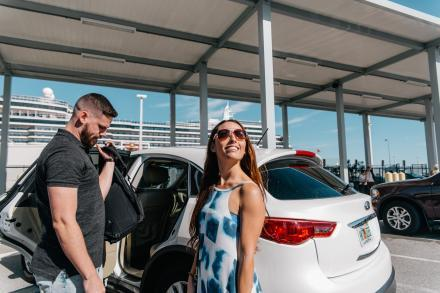 A couple unpacks the car at Port Canaveral for their cruise vacation