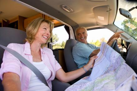 A couple looks at the map while taking a road trip through the Space Coast