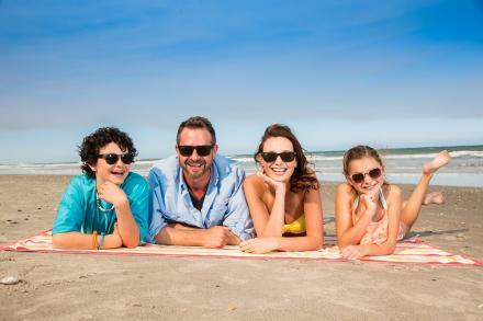 A family soaks in the sun at the beach