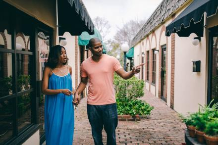 A couple strolls through Cocoa Village
